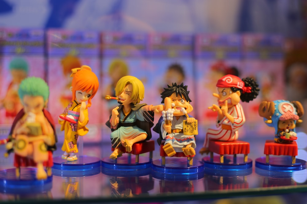 six assorted-color anime character action figures