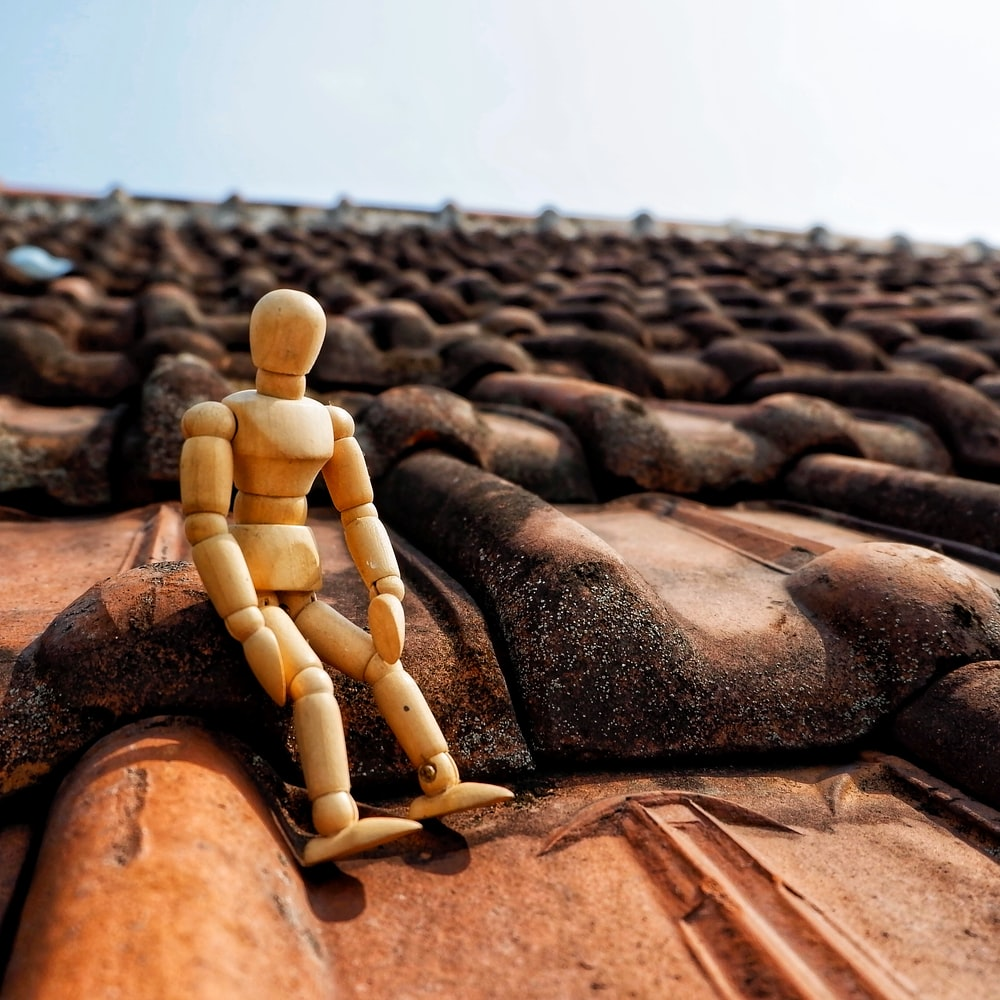 action figure sitting on roof