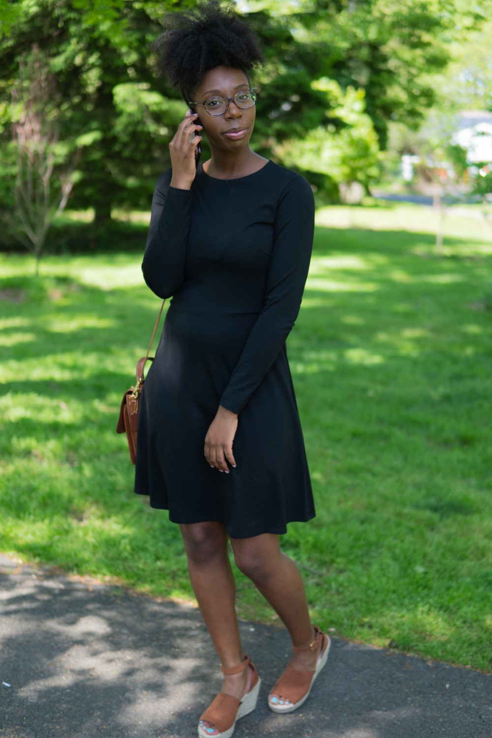 woman in black scoop neck long sleeved midi dress