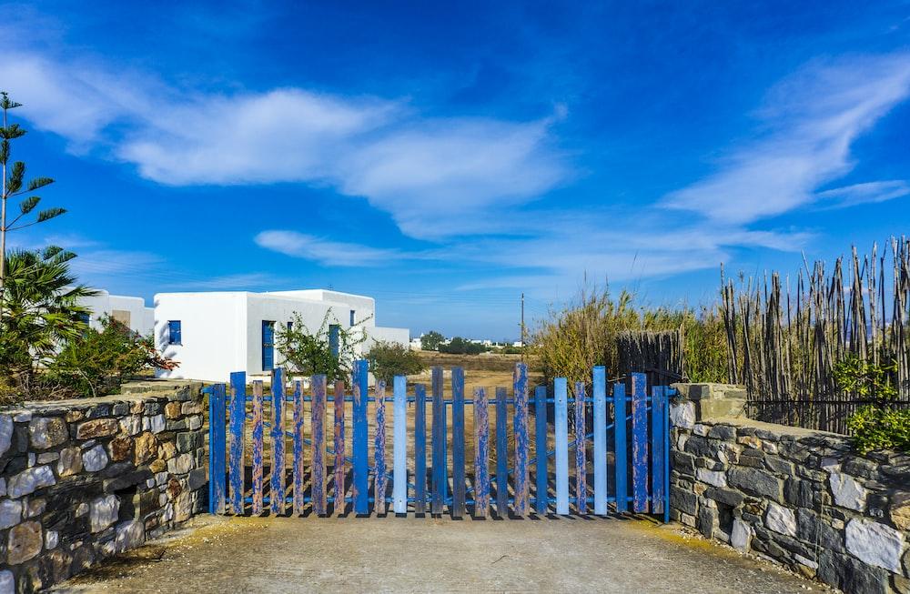 blue wooden gate under blue sky