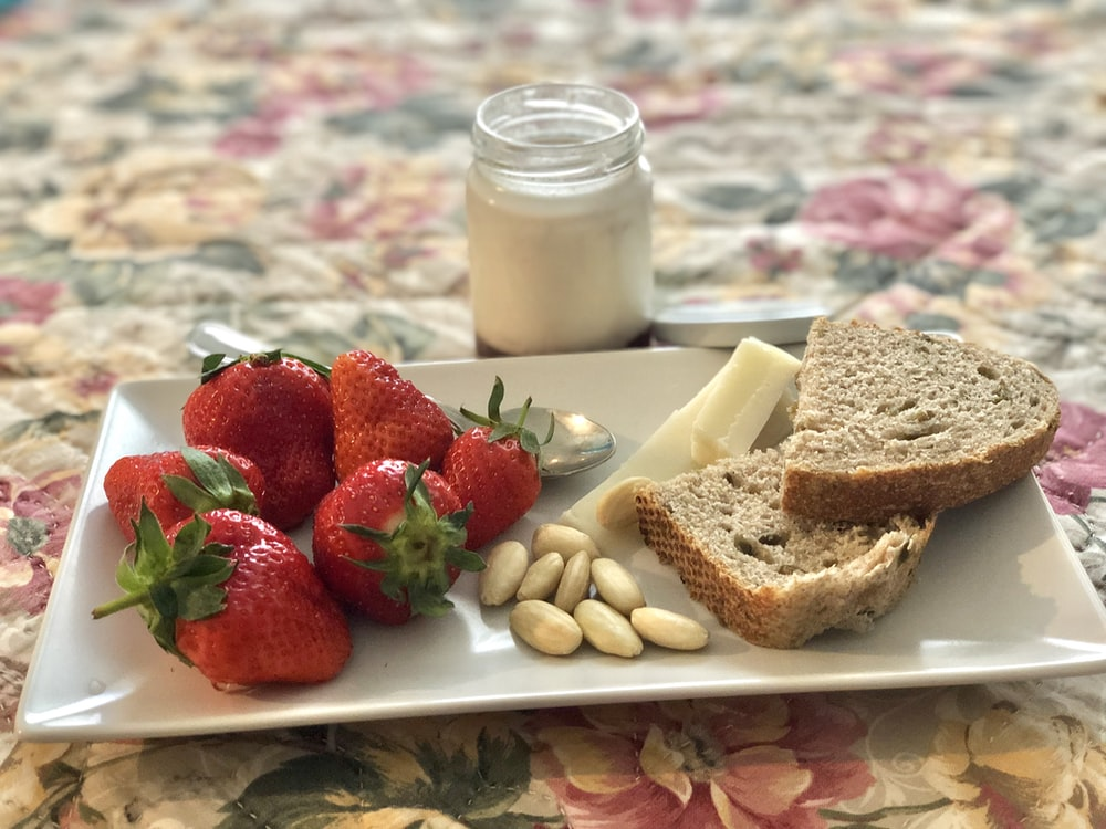 bread and strawberries on plate