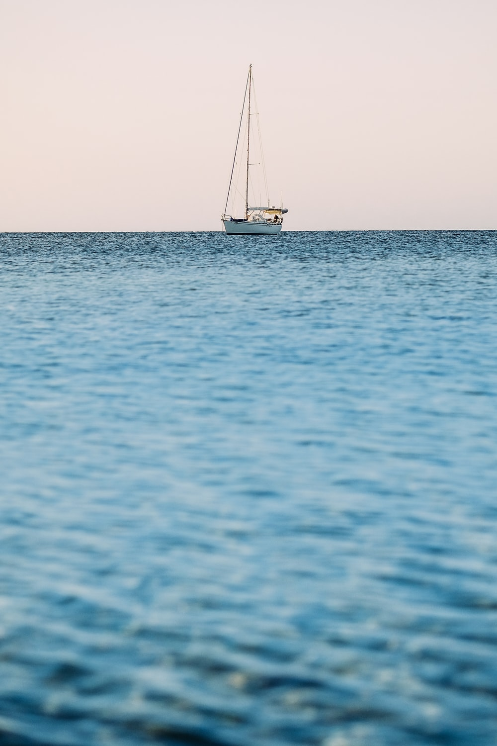 white yacht on blue sea