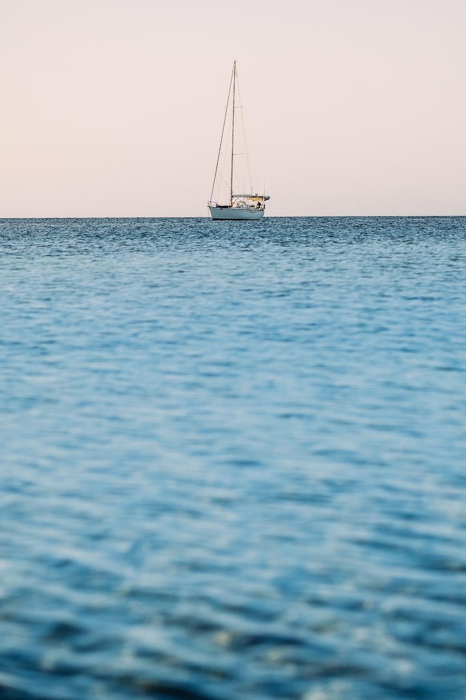 white yacht on blue sea