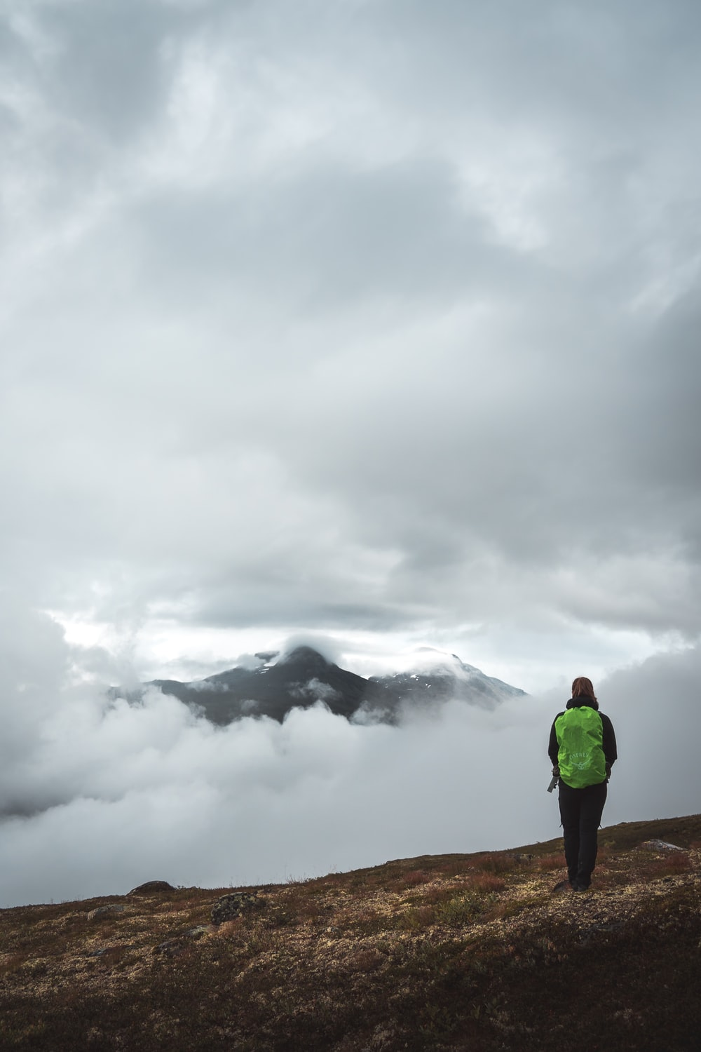 person standing in a mountain during daytime