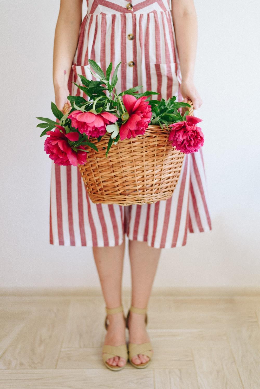 woman holding flower basket