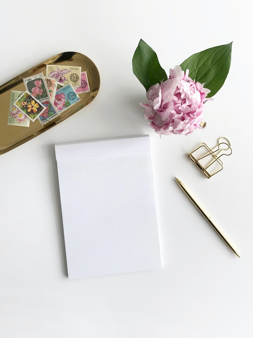 purple flower beside stamps and clip