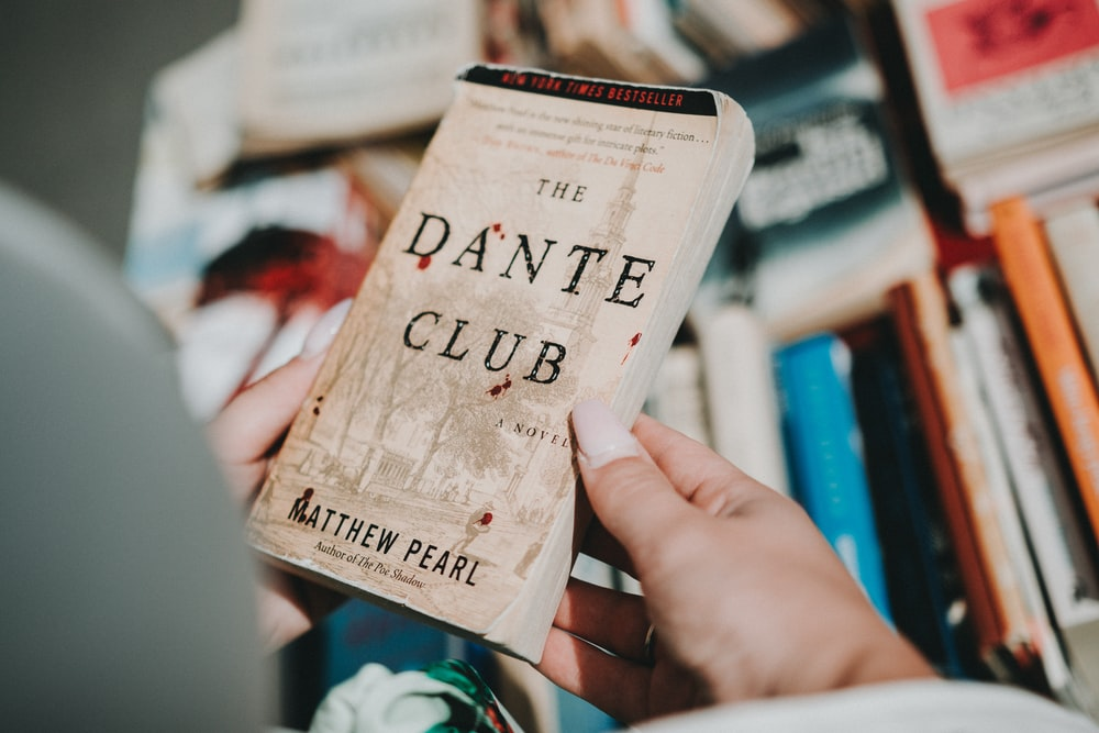 person holding The Dante Club book