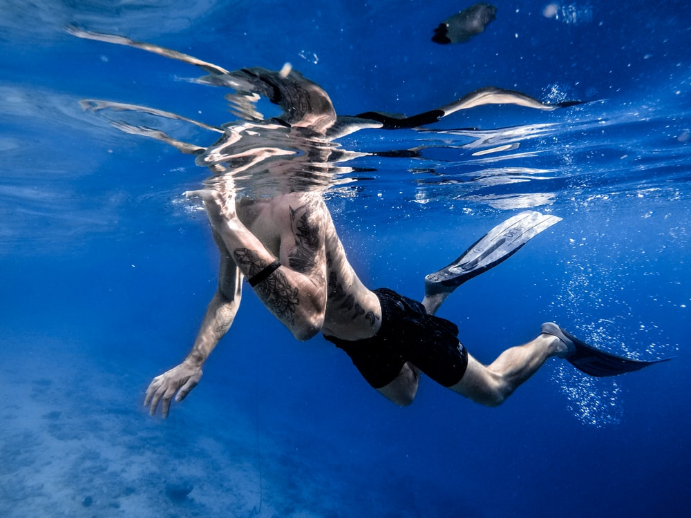 man in swimming pook