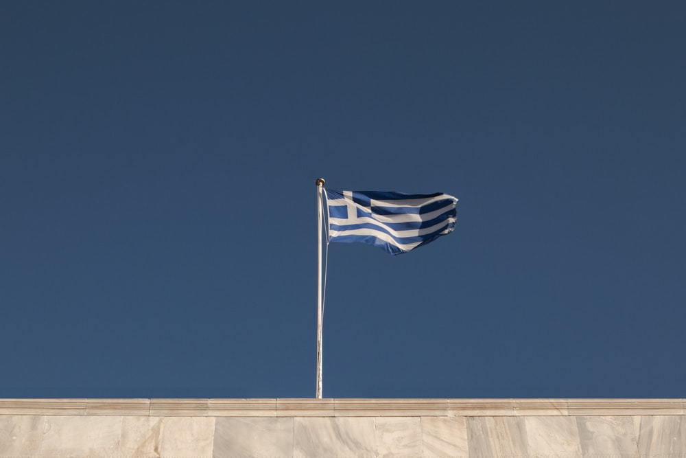 blue and gray flag on rooftop