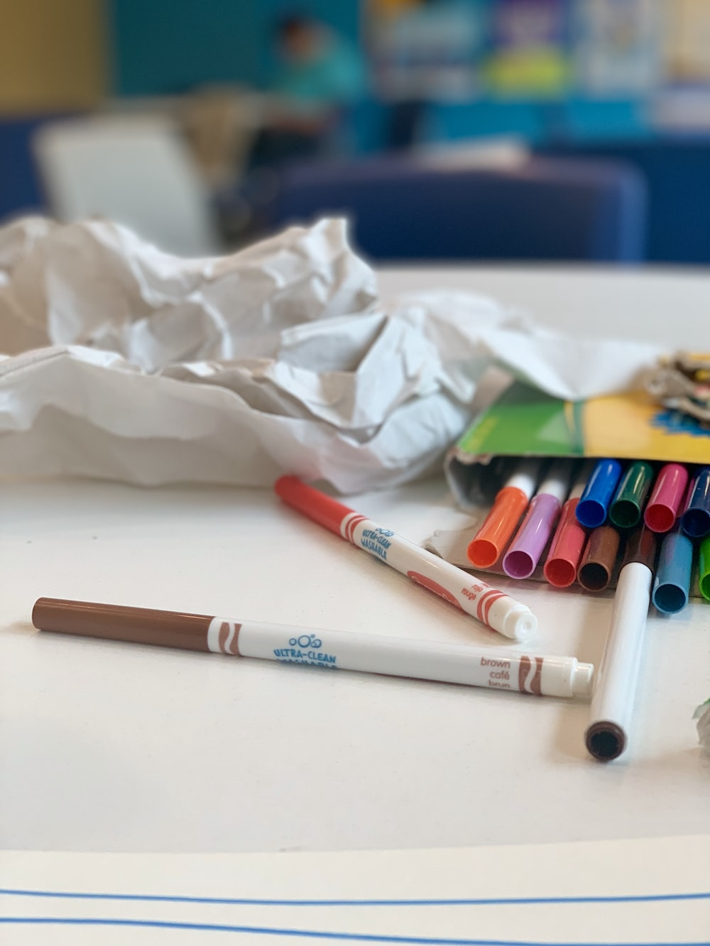 assorted-color color pencil with box on table