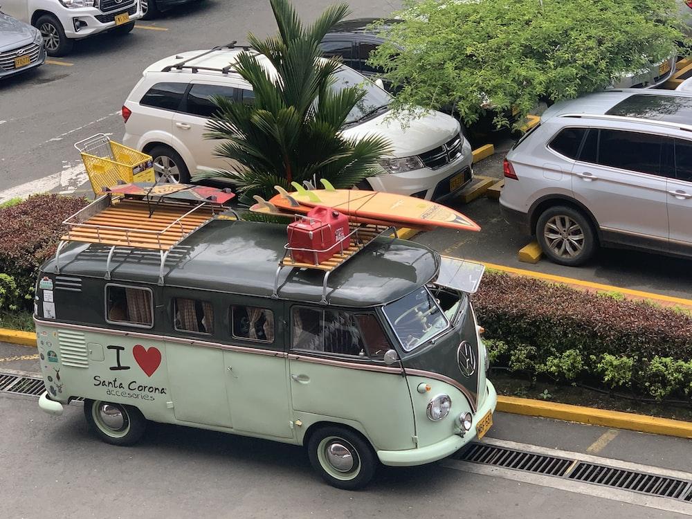 teal and black Volkswagen van