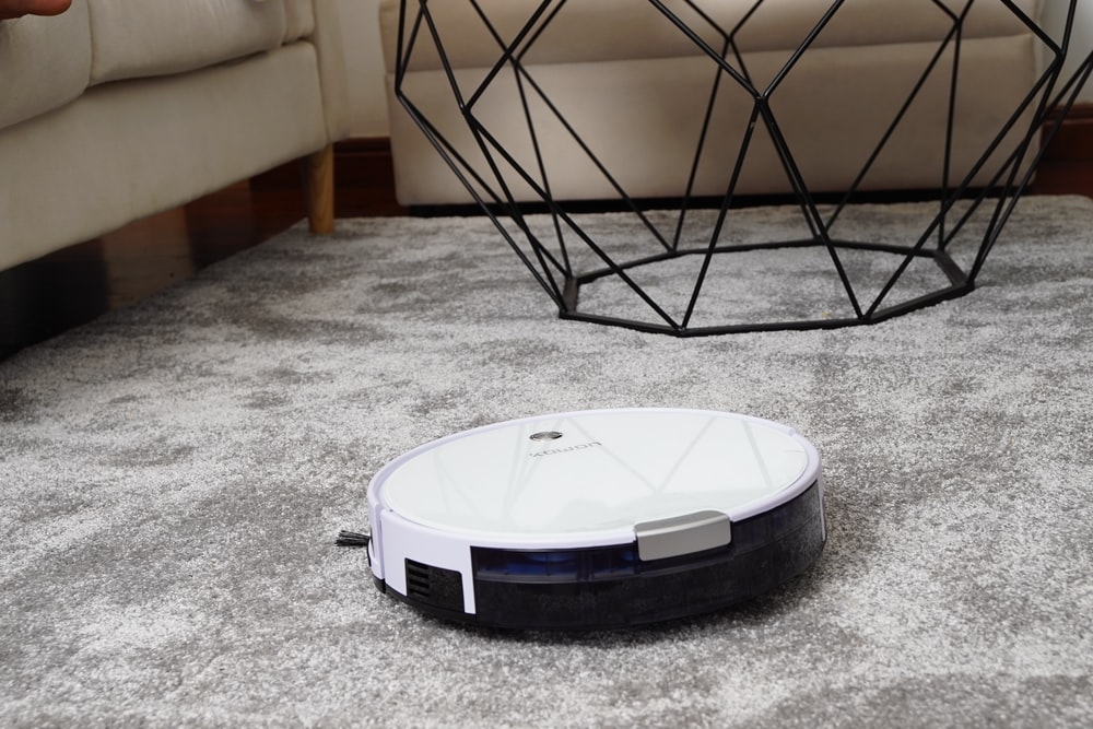 white robot vacuum cleaner on area rug