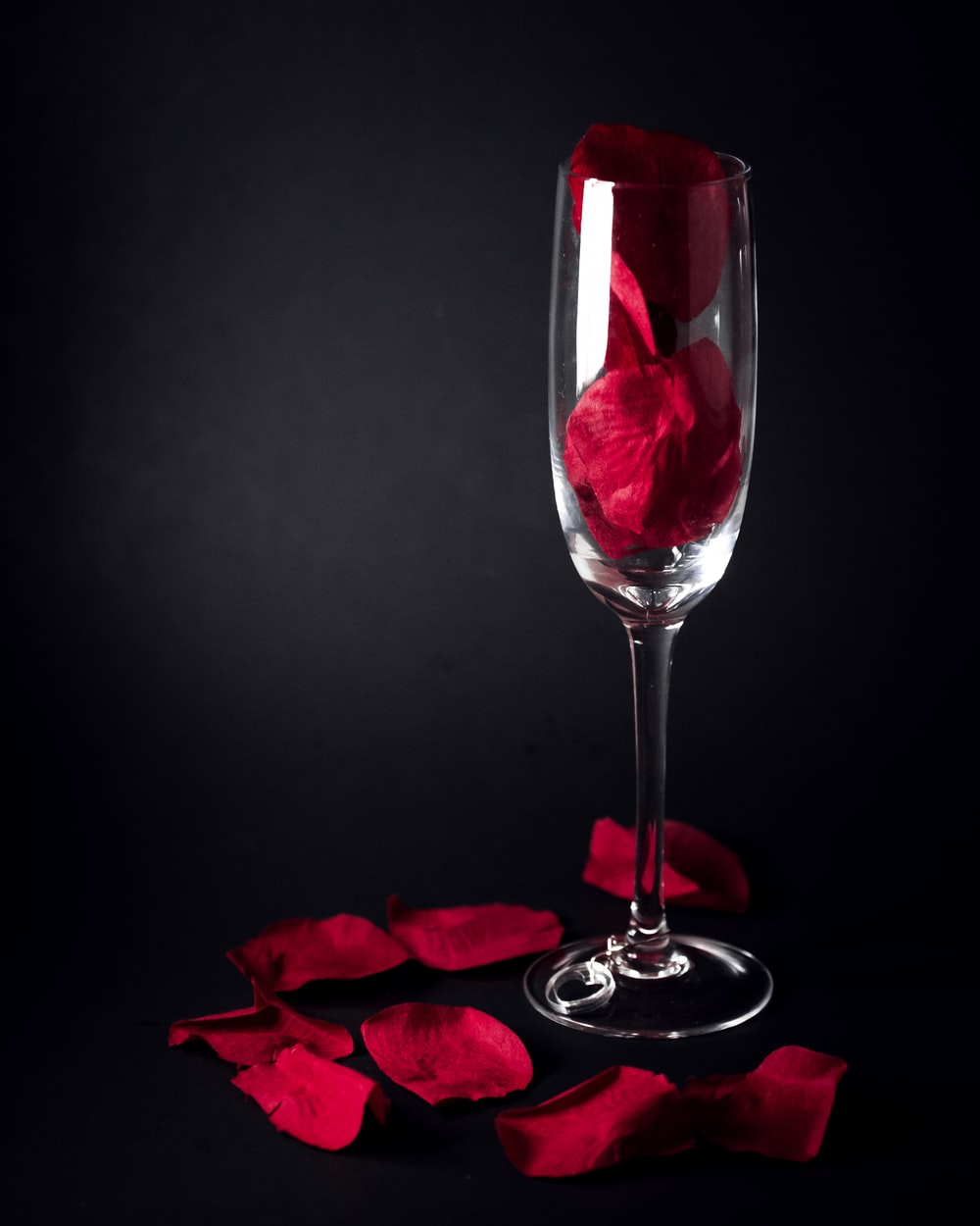 clear champagne flute with roses