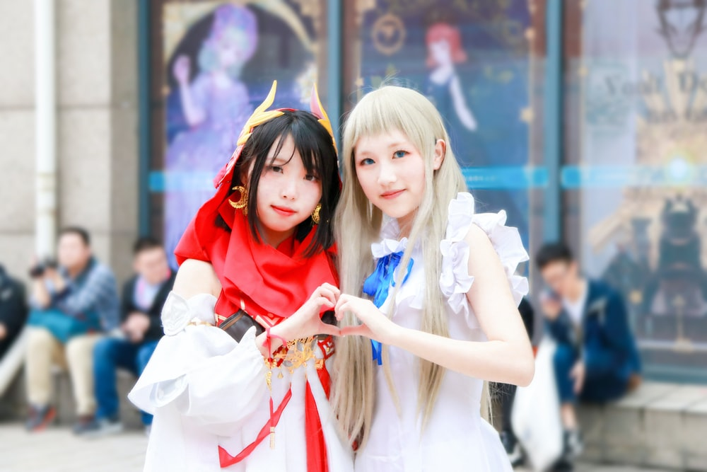 two girl wearing white dress