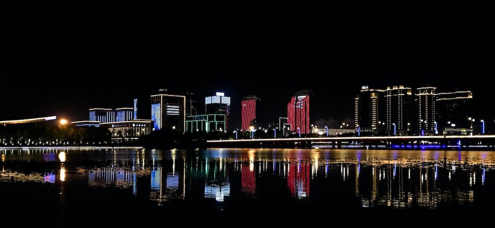 buildings beside body of water