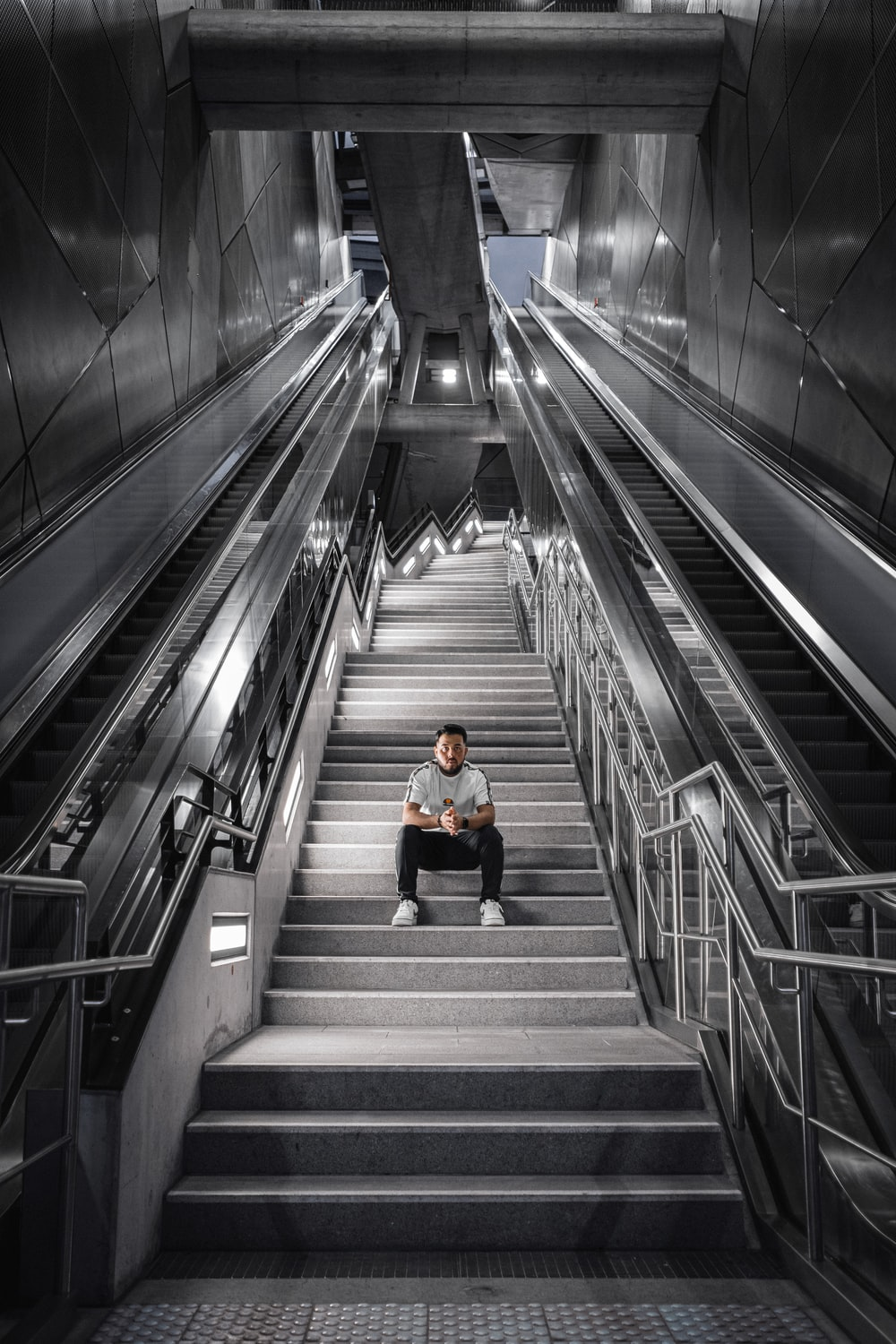 man sitting alone on stairs inside building