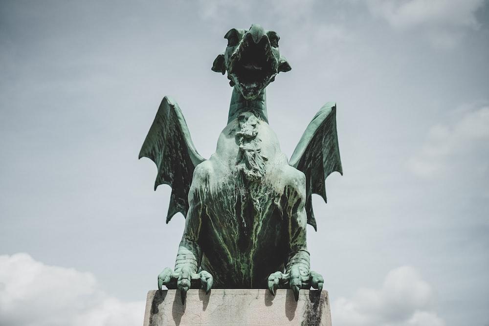 gray concrete dragon statue