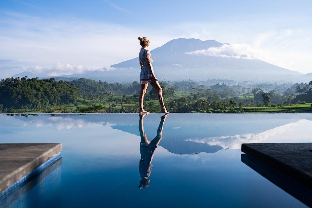 woman walking near the pool