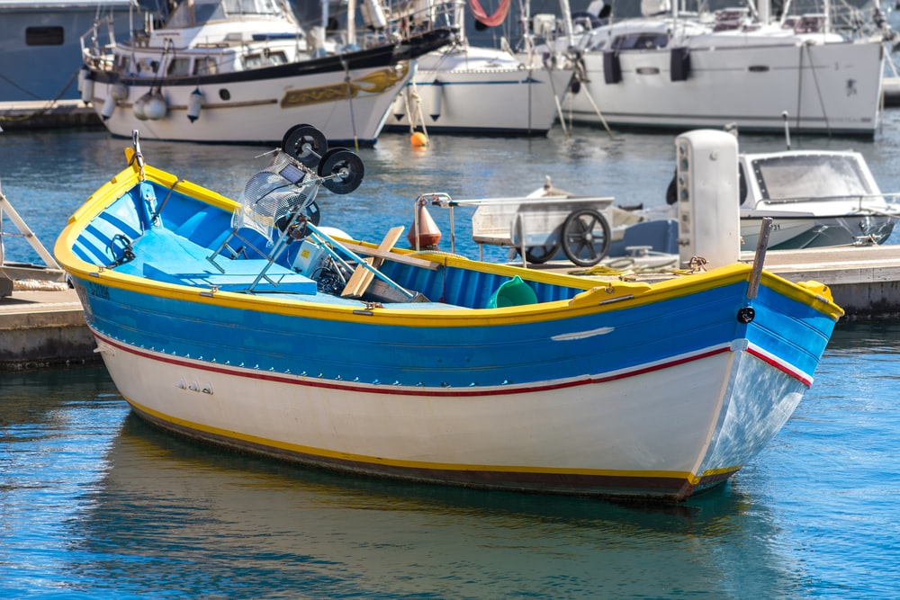 white and blue boat with no people