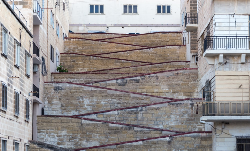 brown concrete pathway near buildings