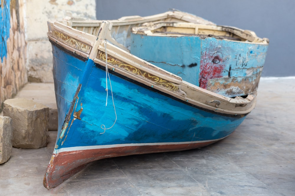 blue and brown canoe photography