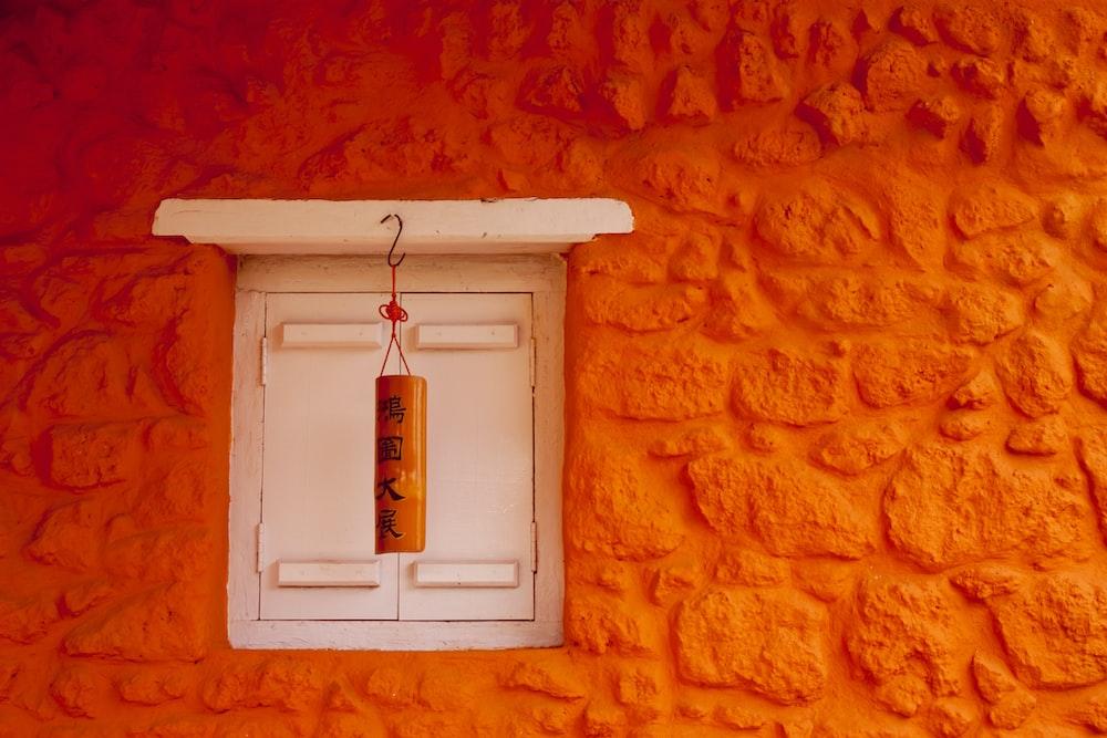 white and orange lantern