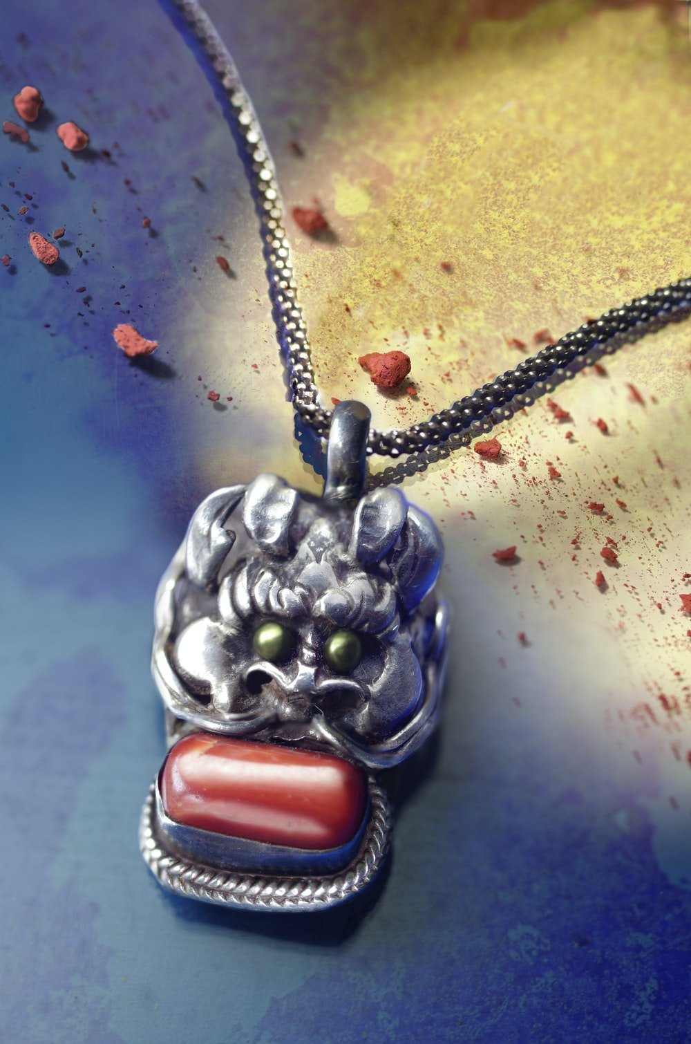 silver dragon with red cabochon pendant