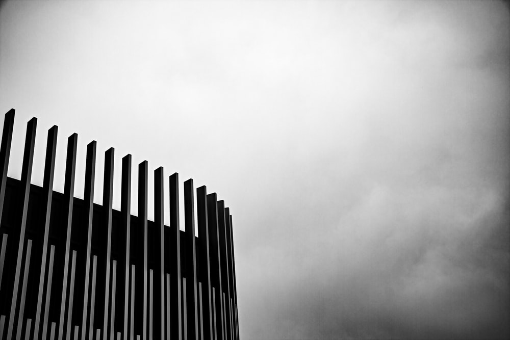 black concrete building under white skies