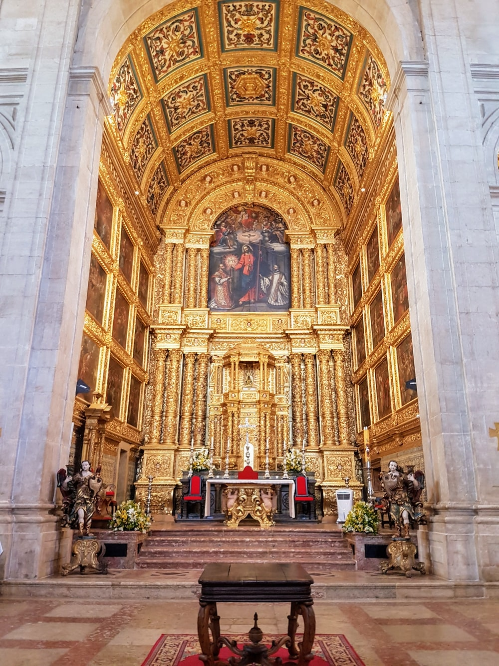 gold and white concrete cathedral interior