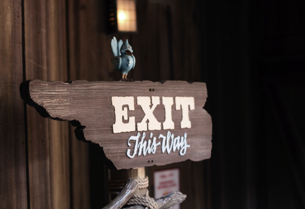 exit this way signage near wall