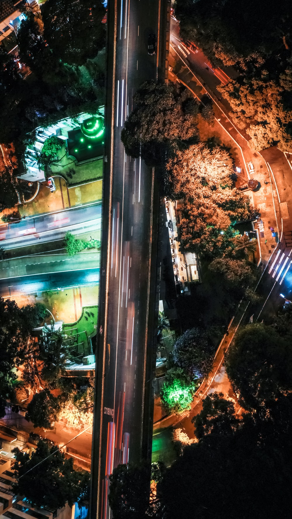 aerial photography of houses and road at night time