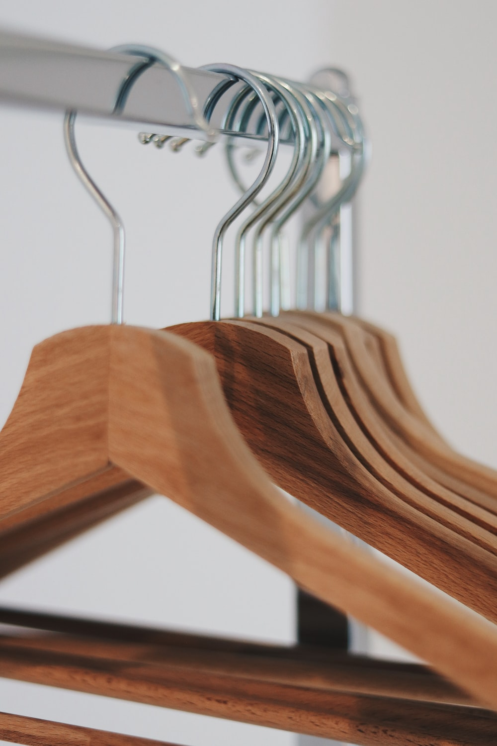brown wooden clothes hangers