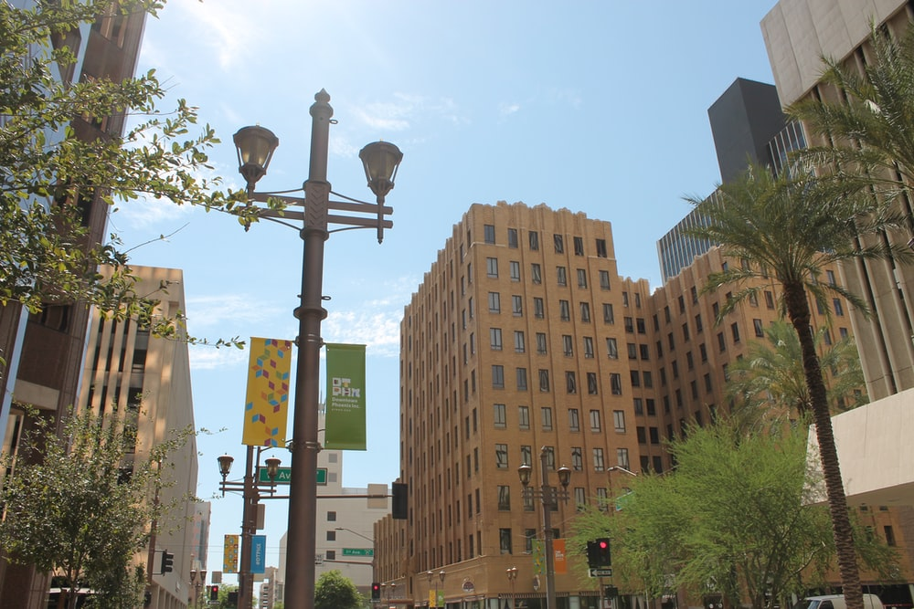 city with high-rise buildings viewing street light with Stop sign