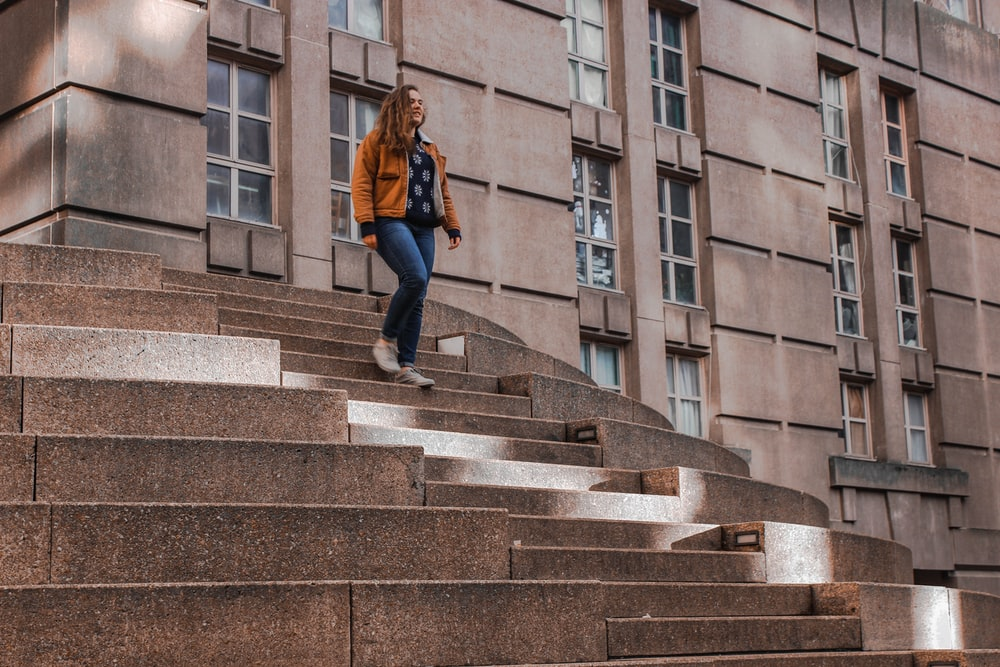 woman walking on stairs