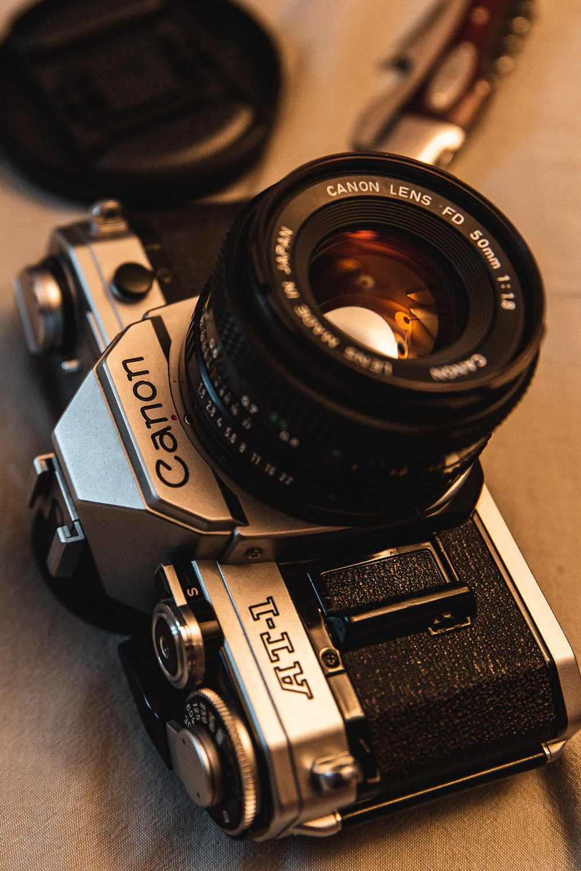 black and gray Canon DSLR camera