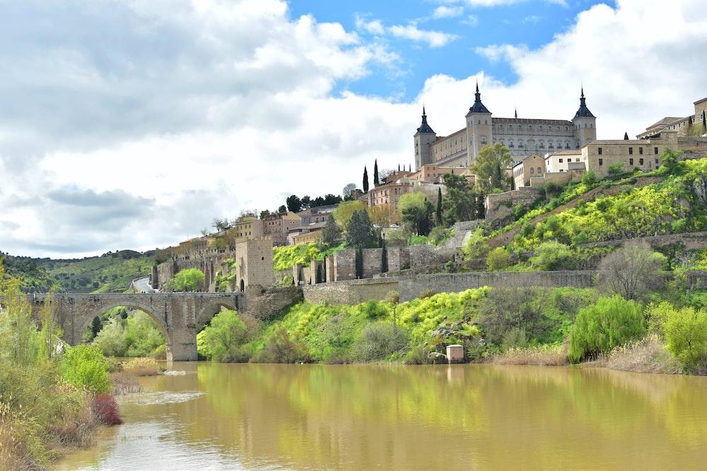 castle beside body of water