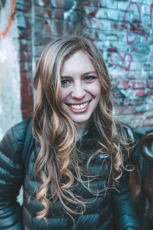 smiling girl wearing black down jacket