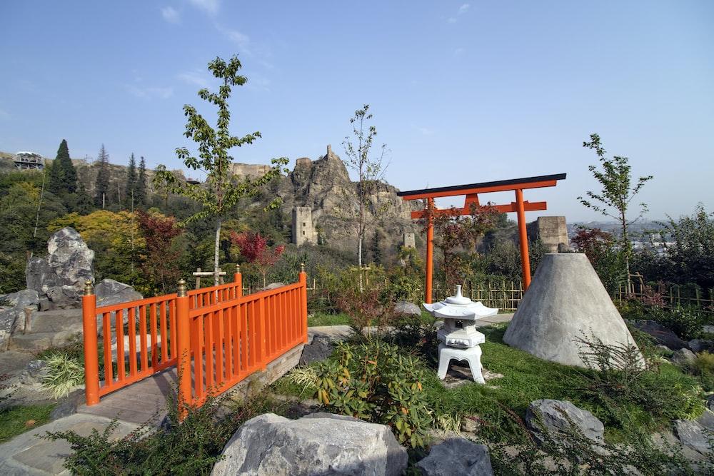 orange wooden bridge railing in park