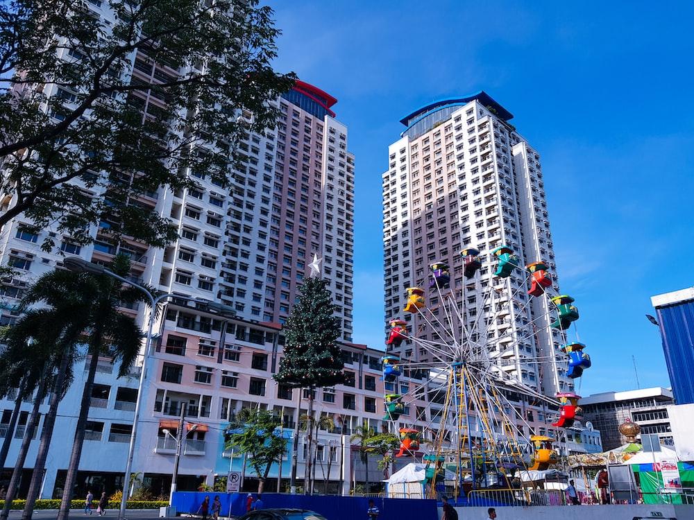 ferrris wheel beside high rise buildings