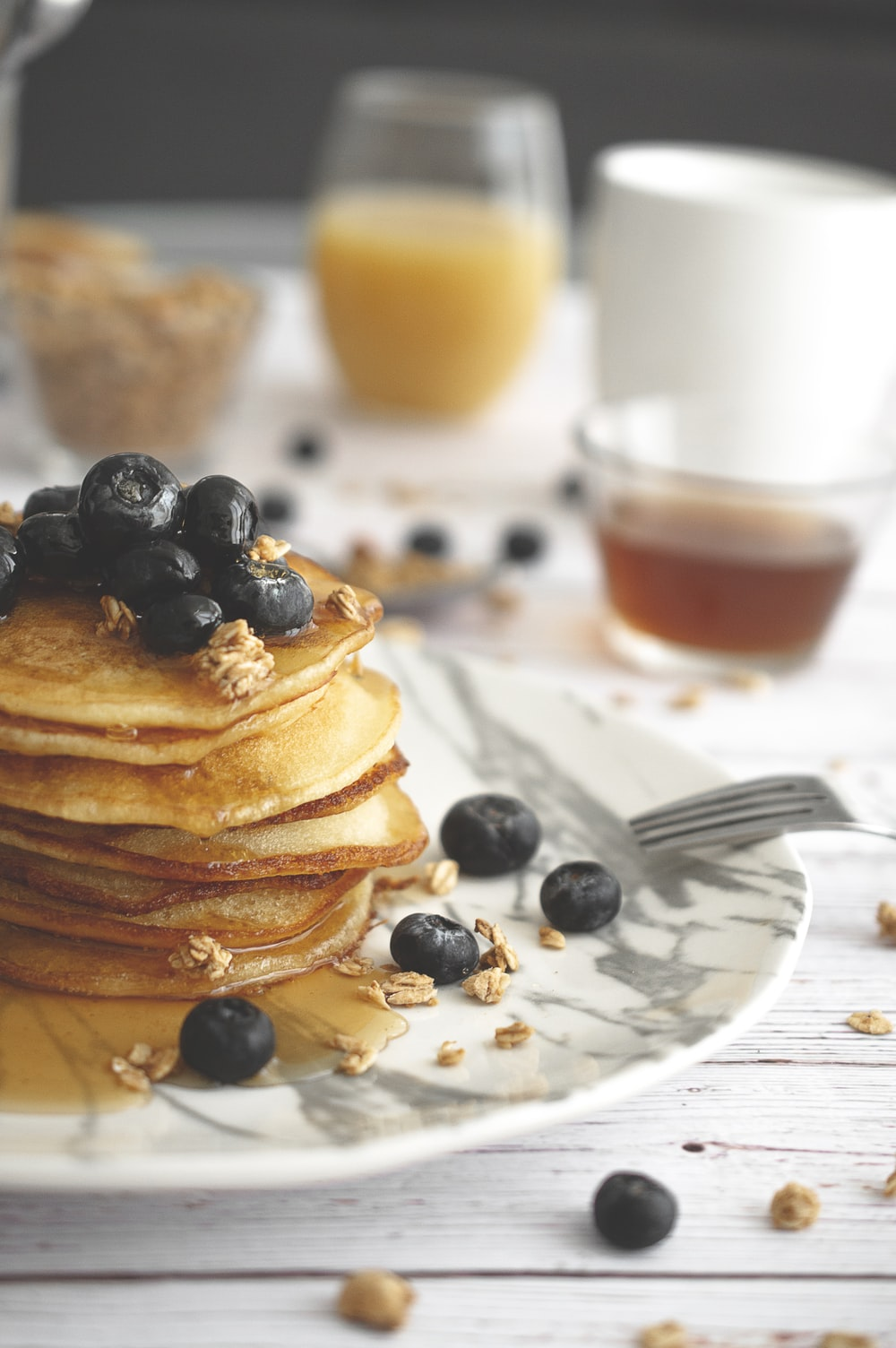 hot cakes and foods on white table