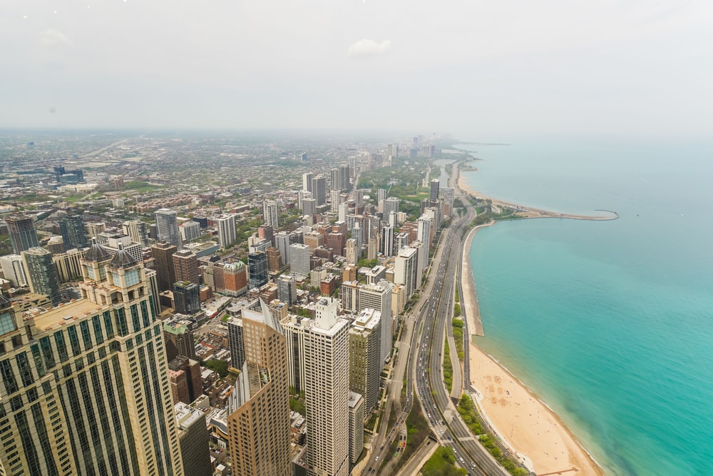 aerial photography of white sand beach and cityscape during daytime