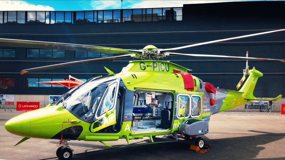 green helicopter on ground