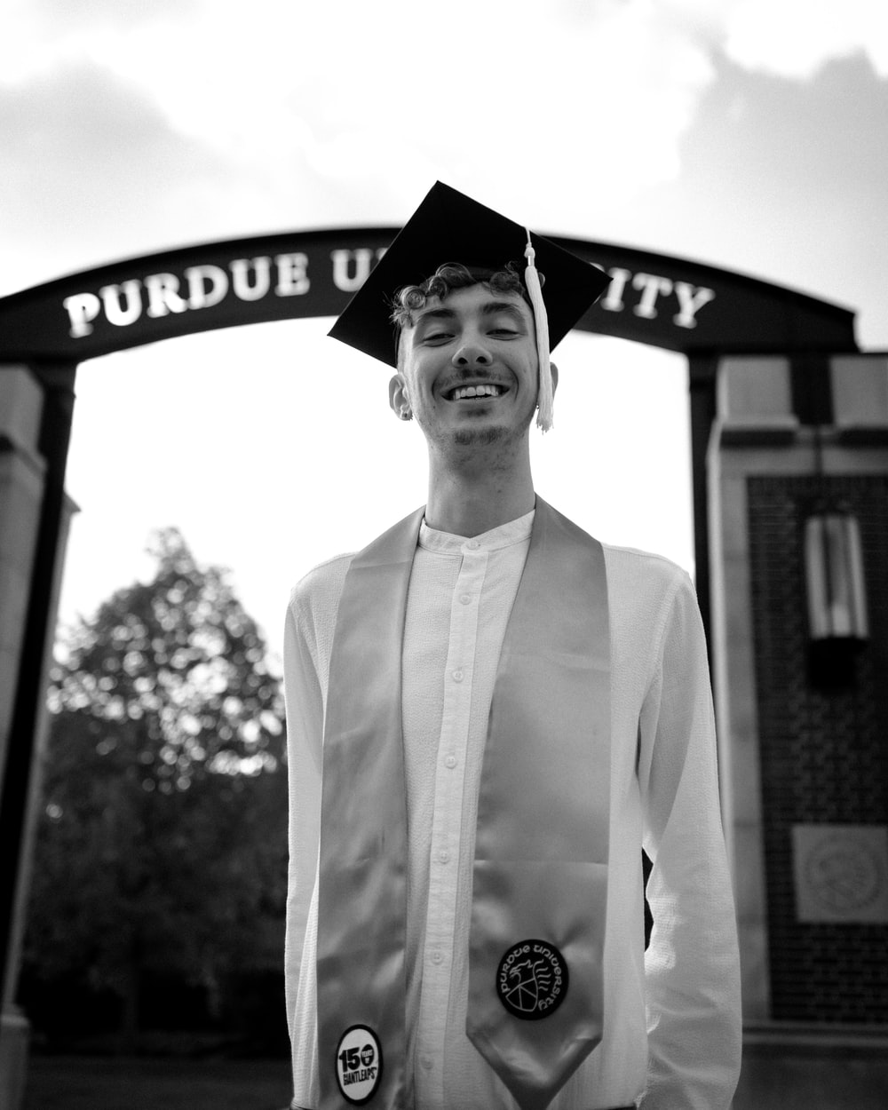 man in thawb with mortar board smiling