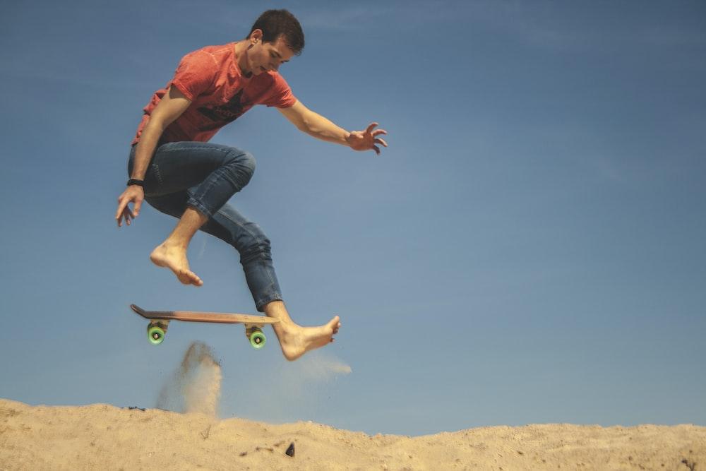 man skateboarding on desert