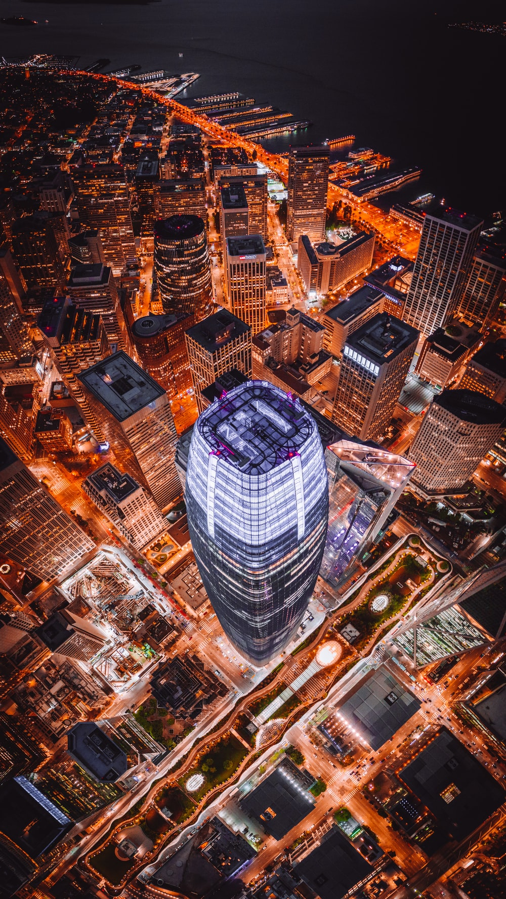 aerial photography of curtain wall high-rise building during night