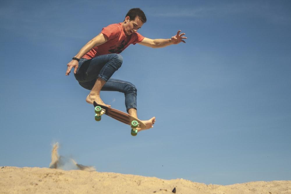 man doing tricks while riding on skateboard