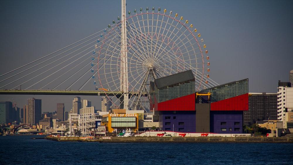 Ferris Wheel in park near bridge