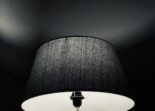 grey tripod floor lamp turned-on