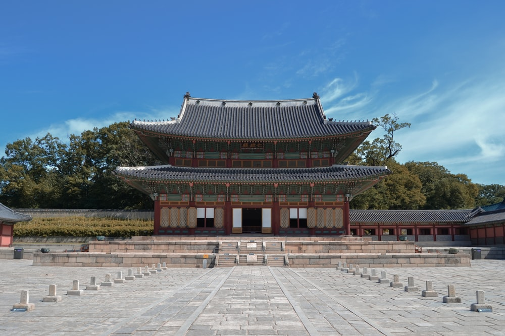 gray and red temple under clear blue sky
