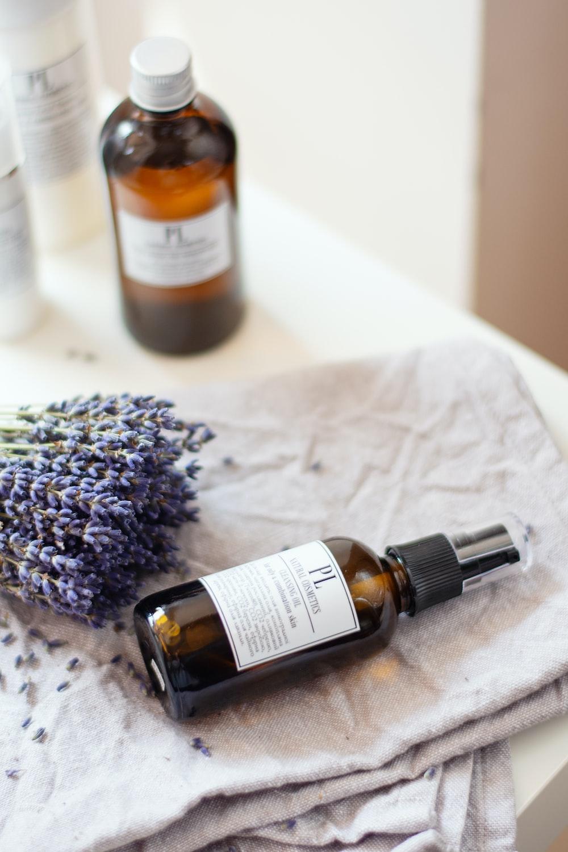 lavender flower between bottles